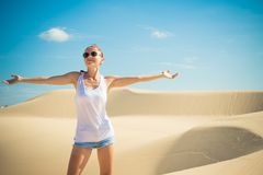 Beautiful woman in sand dunes Royalty Free Stock Image