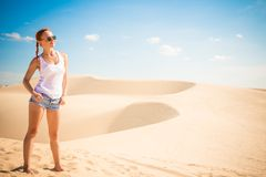 Beautiful woman in sand dunes Royalty Free Stock Photo