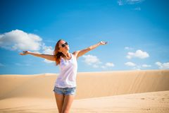 Beautiful woman in sand dunes Royalty Free Stock Images