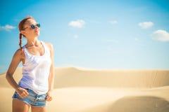 Beautiful woman in sand dunes Stock Photo