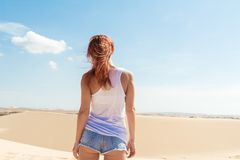 Beautiful woman in sand dunes Royalty Free Stock Photography