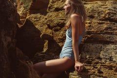 Beautiful woman among sandstones royalty free stock image