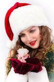 Beautiful woman Santa with a candle Royalty Free Stock Images