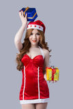 Beautiful woman in Santa Claus clothes Stock Photos