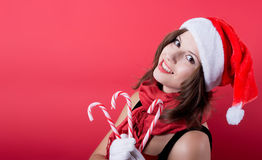 Beautiful woman in Santa Claus clothes over red Royalty Free Stock Images