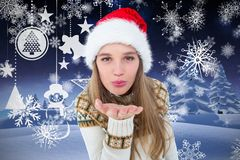 Beautiful woman in santa claus costume blowing a kiss Stock Photo