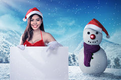 Beautiful woman in santa claus costume holding blank banner Royalty Free Stock Images