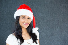 Beautiful woman in santa claus hat Stock Photography