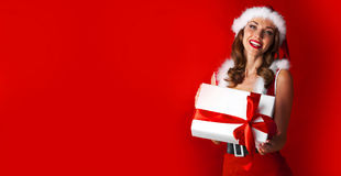 Santa Claus woman with gift Royalty Free Stock Photo