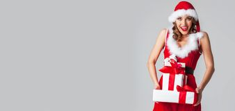 Santa Claus woman with gifts Royalty Free Stock Image