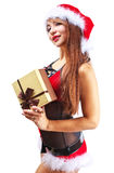 Beautiful woman in santa clause costume holding a gift Royalty Free Stock Photos