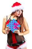Beautiful woman in santa clause costume holding a gift Royalty Free Stock Images