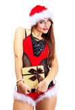 Beautiful woman in santa clause costume holding a gift Stock Photo