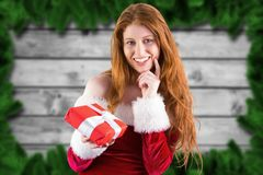 Beautiful woman in santa costume holding a gift box Royalty Free Stock Photography