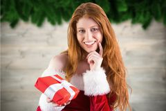 Beautiful woman in santa costume holding a gift Royalty Free Stock Photography