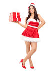 Beautiful woman in Santa costume holding presents Stock Photos