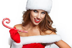 Beautiful woman with santa costume  holding red-white Christmas Stock Photo