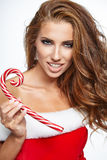 Beautiful woman with santa costume  holding red-white Christmas Stock Photos