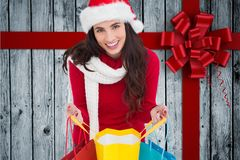 Beautiful woman in santa costume holding shopping bags Stock Photo