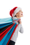 Beautiful woman in santa hat carrying shopping bags. Stock Photos