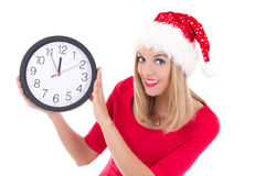 Beautiful woman in santa hat with clock posing isolated on white Stock Image