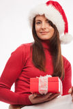 Beautiful woman in a Santa hat with a gift Royalty Free Stock Image