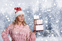 Beautiful woman in Santa hat with giftboxes on Stock Image