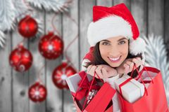 Beautiful woman in santa hat holding bags with gifts Stock Photography