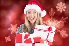 Beautiful woman in santa hat holding christmas gifts Stock Images