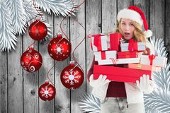 Beautiful woman in santa hat holding christmas gifts Stock Image