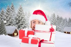 Beautiful woman in santa hat holding christmas gifts Royalty Free Stock Images