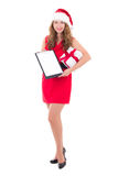 Beautiful woman in santa hat holding clipboard with copyspace an Royalty Free Stock Photography