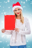 Beautiful woman with santa hat, holding a red paper without subtitles Royalty Free Stock Images