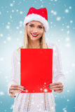 Beautiful woman with santa hat, holding a red paper without subtitles Stock Photos