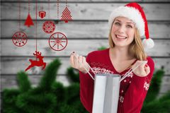 Beautiful woman in santa hat holding a shopping bag Royalty Free Stock Photo