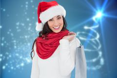 Beautiful woman in santa hat holding a shopping bag Royalty Free Stock Photography