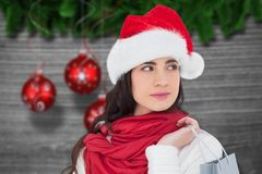 Beautiful woman in santa hat holding a shopping bag Stock Photo