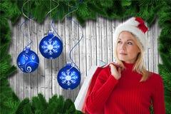 Beautiful woman in santa hat holding shopping bags Stock Photos