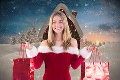 Beautiful woman in santa hat holding shopping bags Royalty Free Stock Photos