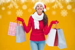 Beautiful woman in santa hat holding shopping bags Stock Photo