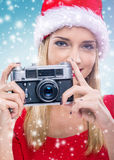 Beautiful woman with santa hat, holding two red gift box - snowfall Royalty Free Stock Photos