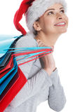 Beautiful woman in santa hat with shopping bags. Stock Photography