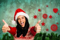 Beautiful woman in santa hat showing thumbs up Royalty Free Stock Photos
