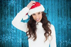 Beautiful woman in santa hat smiling at camera Royalty Free Stock Photography