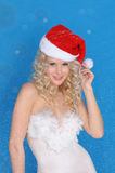 Beautiful woman in Santa hat and snow Stock Photography