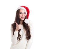 Beautiful woman in santa hat thumbs-up. Stock Image