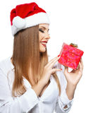 Beautiful woman with Santa's hat holding a present royalty free stock photos