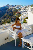 Beautiful woman on Santorini, Thira town Royalty Free Stock Photography