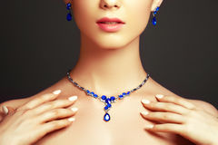 Beautiful woman with a sapphire necklace. Fashion concept. Elegant fashionable woman with jewelry. Beautiful woman with a sapphire necklace. Beauty young model royalty free stock photography