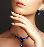 Beautiful woman with a sapphire necklace. Fashion concept. Elegant fashionable woman with jewelry. Beautiful woman with a sapphire necklace. Beauty young model stock photos